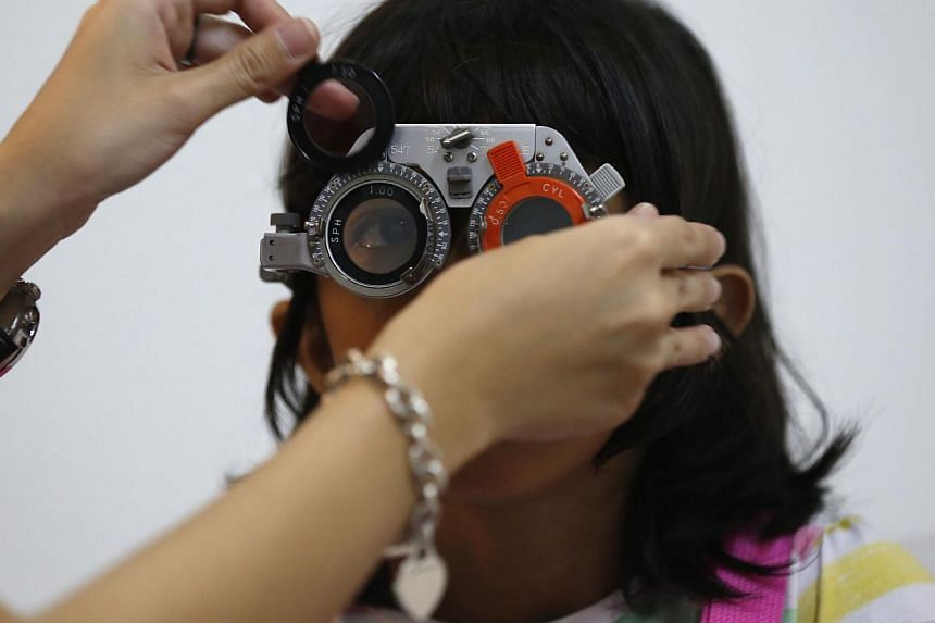 Instead of merely asking to test how well you can see, you should ask for a more comprehensive eye health check the next time you visit a spectacle shop, say experts. -- ST PHOTO: KEVIN LIM