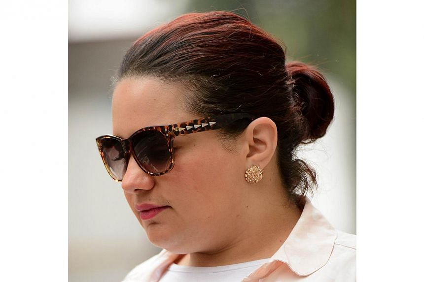 A file picture taken on Aug 8, 2014, shows Amal El-Wahabi arriving at the Old Bailey court in central London. El-Wahabitried to send €20,000 (S$32,000) to her husband fighting with Islamic State group in Syria and was on Thursday jailed for 2