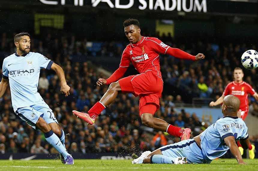 Liverpool's Daniel Sturridge (centre) is challenged by Manchester City's Gael Clichy (left) and Vincent Kompany during their English Premier League soccer match at the Etihad stadium in Manchester, northern England Aug 25, 2014. Sturridge said Wednes