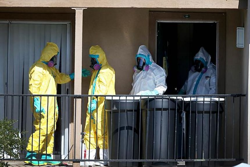 Hazmat workers sanitise the apartment where Ebola patient Thomas Eric Duncan was staying before being admitted to a hospital on Oct 5, 2014 in Dallas, Texas. The family of Thomas Eric Duncan, the first person to die of Ebola in the United States