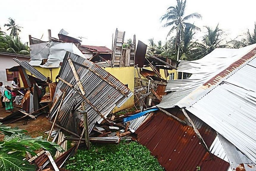 Scene of disaster: One of the houses in Kampung Sungai Nonang badly damaged after it was hit by a mini tornado on Wednesday. -- PHOTO: THE STAR/ASIA NEWS NETWORK