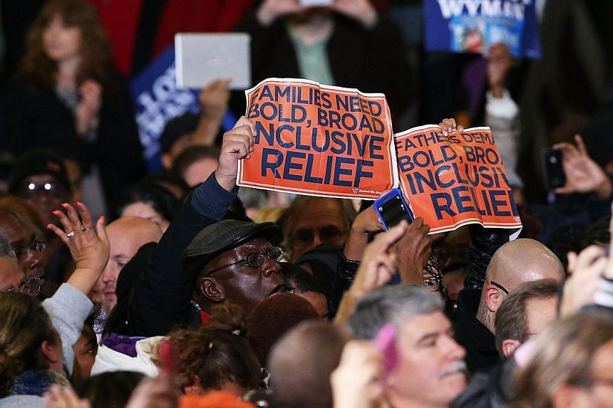 Hecklers on immigration policy interrupt US President Barack Obama as he speaks in support of of Connecticut Governor Dan Malloy in Bridgeport, Connecticut on Nov 2, 2014. -- PHOTO: AFP