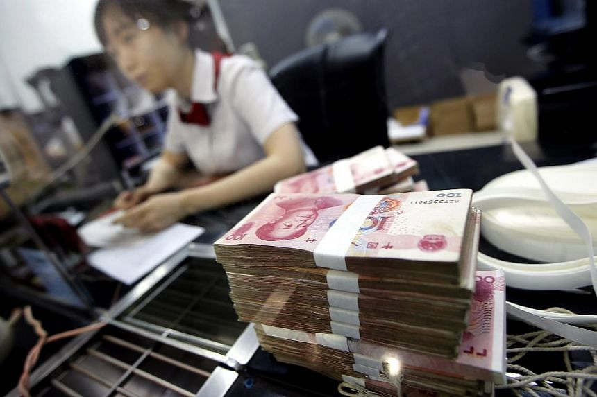 The Singapore dollar became the latest currency to be allowed to trade directly with the Chinese yuan, joining an exclusive club of only eight other currencies that can do so. -- PHOTO: REUTERS