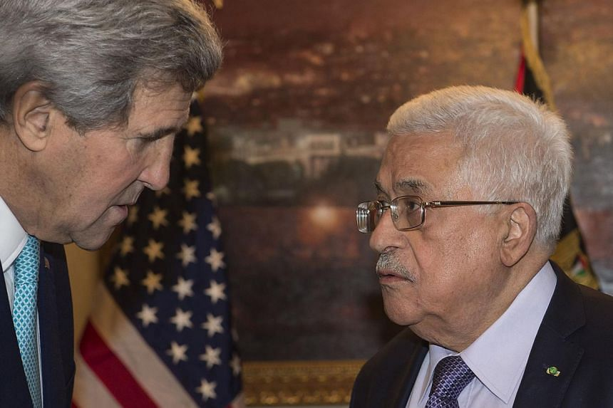 US Secretary of State John Kerry (left) meets with Palestinian President Mahmoud Abbas at his residence in Amman on Nov 13, 2014 to discuss the upsurge in violence in east Jerusalem and the West Bank. Kerry arrived in Jordan late on Nov 12 for talks