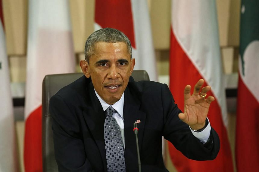 US President Barack Obama speaks at a meeting with more than 20 foreign defence chiefs to discuss the coalition efforts in the ongoing campaign against ISIS at Joint Base Andrews in Washington, Oct 14, 2014. -- PHOTO: REUTERS
