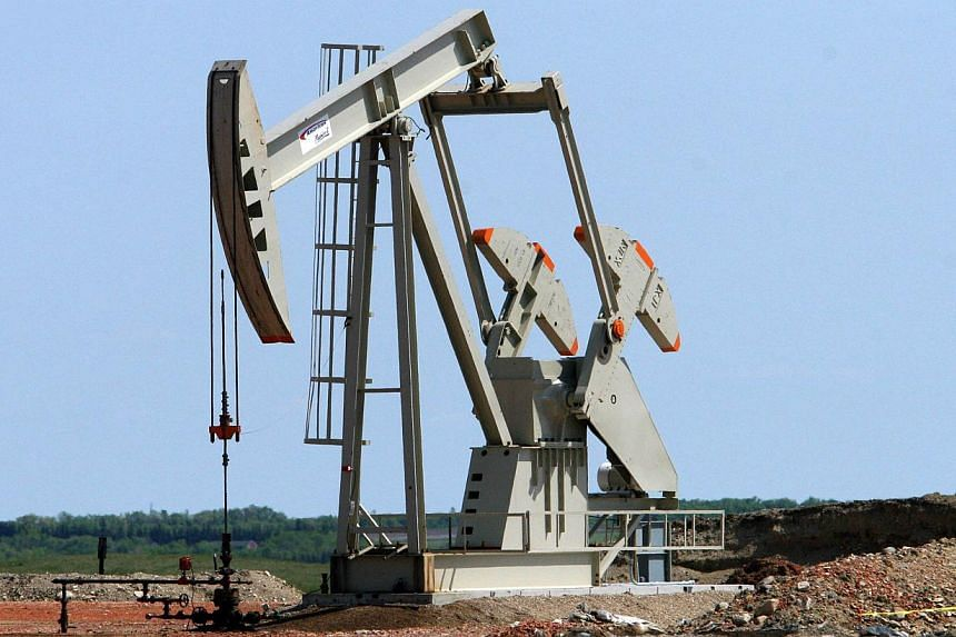 Fall in oil prices to lowest levels in more than three years should give boost to sagging world economy, says IMF. -- PHOTO: AFP