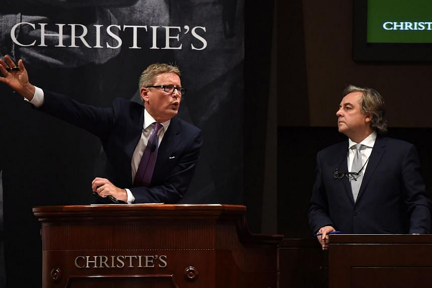 Christie's auctioneers in action in New York on Wednesday where theysold a record US$852.9 million (S$1.1 billion) of contemporary and post-war art on Wednesday evening. -- PHOTO: REUTERS