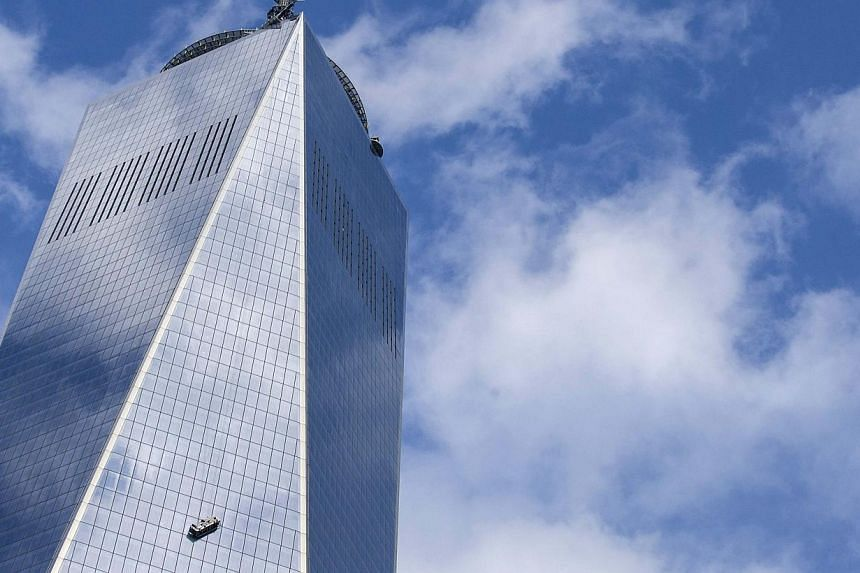 Stranded window washers hang on the side of One World Trade Center Nov 12, 2014. Two window washers were rescued at the new World Trade Center on Wednesday after the cable secured to their platform snapped and left them dangling 69 floors up for near