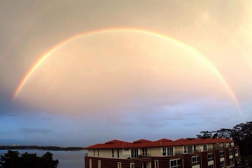 A double rainbow arches across the sky in a picture taken at Sembawang Beach on Nov 13, 2014. -- PHOTO: RACHEL LING