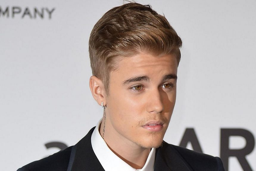 A photo taken on May 22, 2014 photo shows Canadian singer Justin Bieber at the 67th Cannes Film Festival in southern France. -- PHOTO: AFP