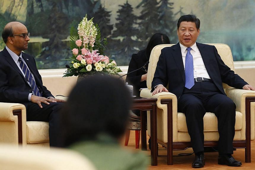 China's President Xi Jinping (right) meets with the guests at the Asian Infrastructure Investment Bank launch ceremony at the Great Hall of the People in Beijing on Oct 24, 2014. -- PHOTO: REUTERS