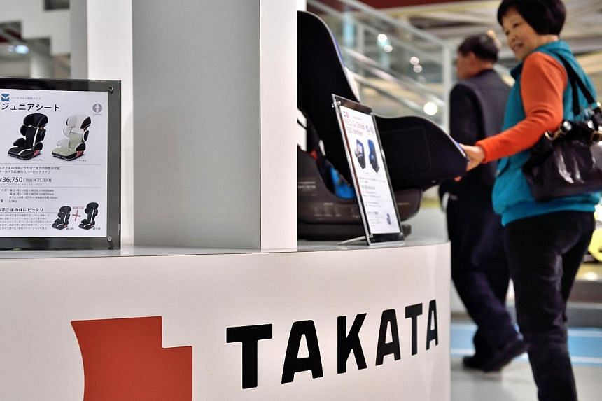 A photo taken on Nov 11, 2014 shows Japanese auto parts maker Takata's accessories on display at a car showroom in Tokyo. -- PHOTO: AFP