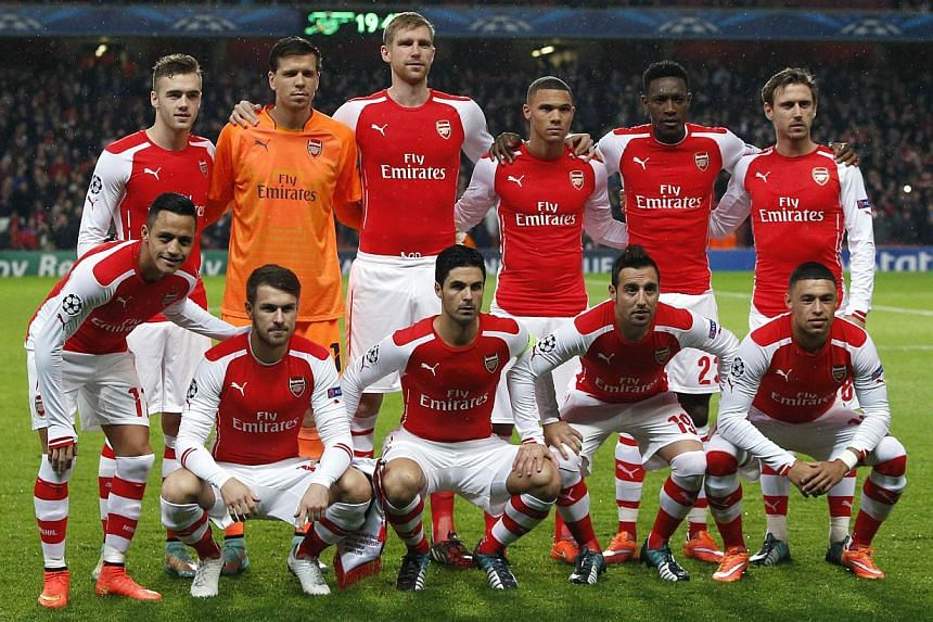 Arsenal players pose for a team picture before the start of the UEFA Champions League Group D football match between Arsenal and Anderlecht at the Emirates Stadium in north London on Nov 4, 2014.The English Premier League's (EPL) only pre-sea