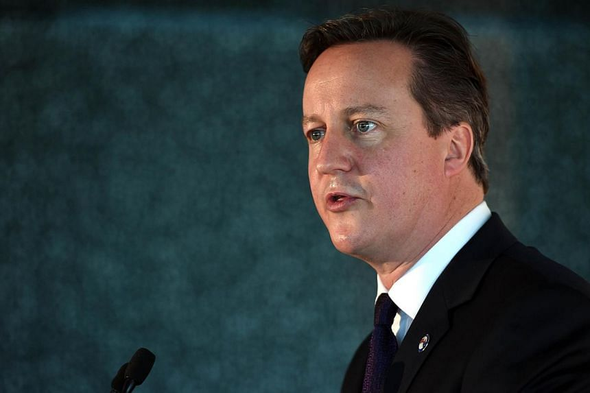 British Prime Minister David Cameron addresses an infrastructure business breakfast in Sydney on Nov 14, 2014. Prime Minister David Cameron on Friday outlined plans to seize passports from radicalised Britons and stop them returning from fightin