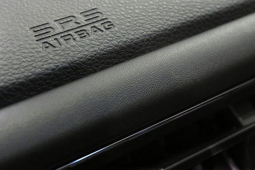 An airbag logo is seen on a dashboard of a Honda Motor Co's car displayed at the company's showroom in Tokyo in this file photo taken Oct 27, 2014. About 400 vehicles here will be recalled due to faulty Takata-made airbags, the Land Transport Au