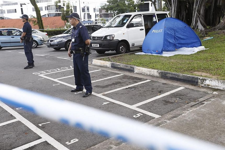 An Indian man in his 30s was found dead at the rear of a white van in a carpark at Sembawang Park on Friday afternoon.-- ST PHOTO: KEVIN LIM