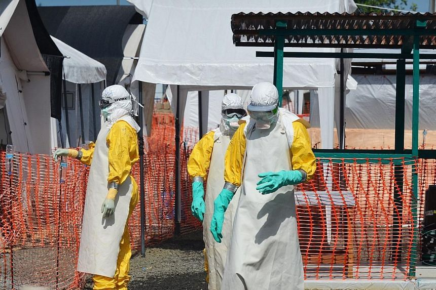 Millions of lives could be lost in a global pandemic if the international community repeats its tardy response to West Africa's Ebola outbreak, World Bank President Jim Yong Kim warned Friday. -- PHOTO: AFP