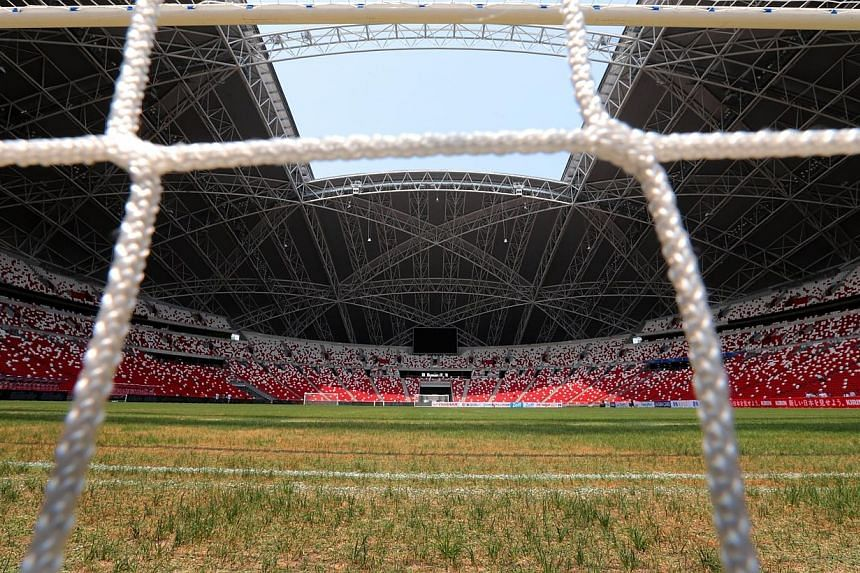 The state of the National Stadium pitch has been the subject of much debate. -- PHOTO: THE NEW PAPER FILE