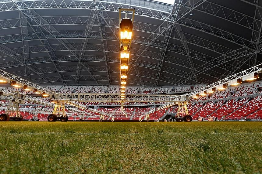 To stimulate the growth of its rye and blue grass seeds, the Singapore Sports Hub has installed $1.5 million worth of special lighting equipment. -- ST PHOTO:SEAH KWANG PENG