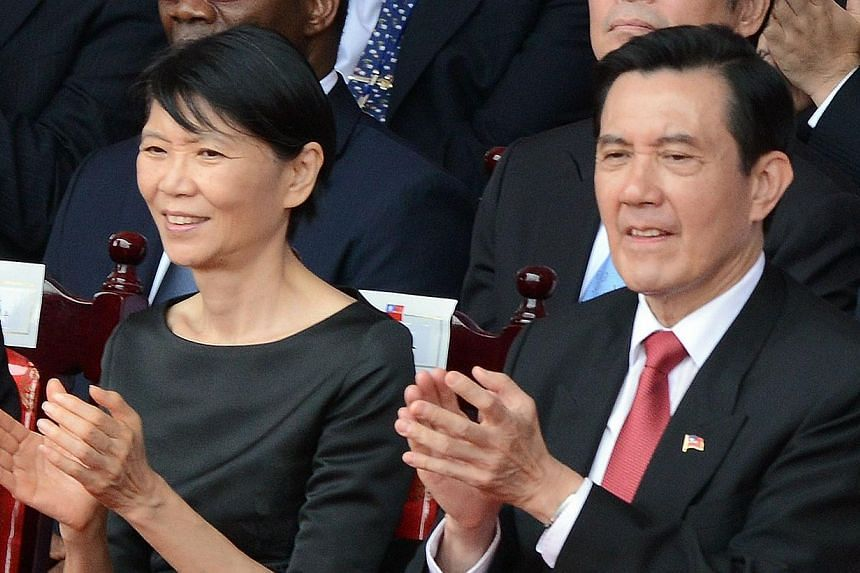 Taiwan President Ma Ying-jeou (right) and his wife Chow Mei-ching applaud during the national day anniversary in front of the Presidential Palace in Taipei on Oct 10, 2014. -- PHOTO: REUTERS