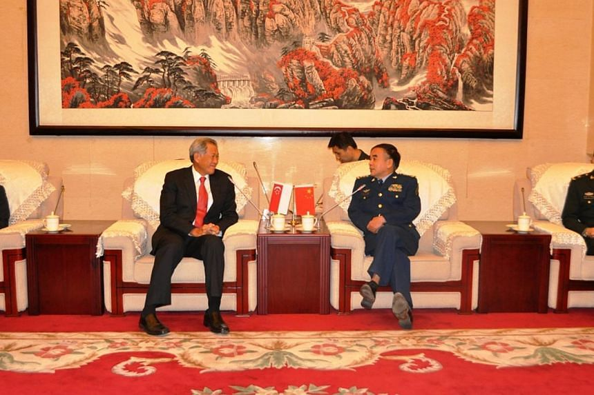 Minister for Defence Dr Ng Eng Hen (second from left) meeting with Political Commissar People's Liberation Army National Defense University (PLA NDU), General (GEN) Liu Yazhou. Singapore and China have agreed to expand their military ties, aft