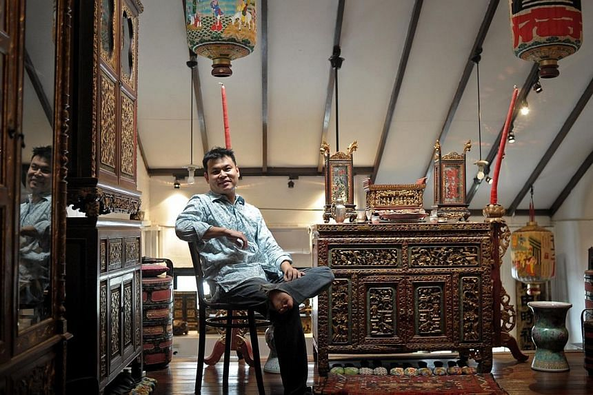 Mr Alvin Yapp, 41, lives in The Intan, a post-war terrace house in Joo Chiat that he transformed into a boutique Peranakan museum with artefacts amassed over 20 years. -- PHOTO: ST FILE