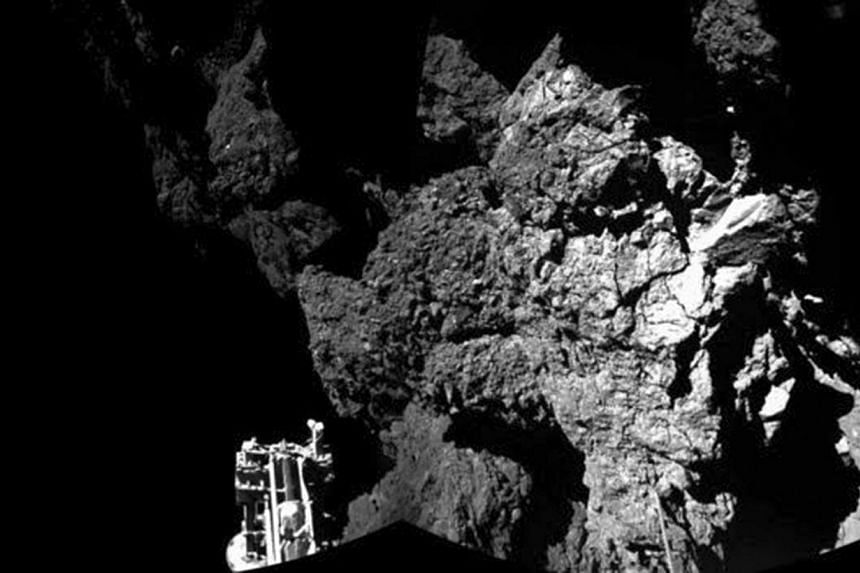 A probe named Philae is seen after it landed safely on a comet, known as 67P/Churyumov-Gerasimenko, in this CIVA handout image released on Nov 13, 2014. Europe's robot lab Philae may not have enough power to send to Earth the results of Friday's
