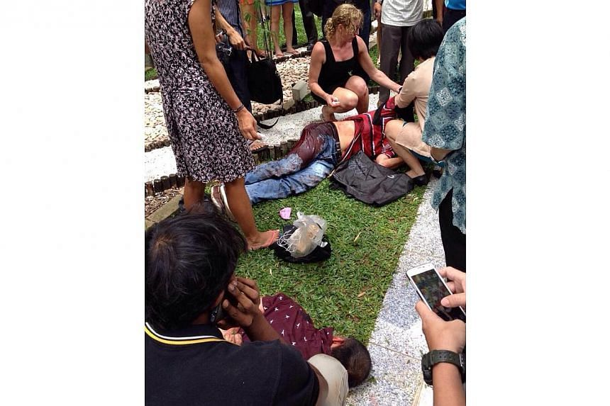 A fight between two men apparently broke out at Raffles Green during lunchtime on Friday, leaving one badly wounded. -- PHOTO: ST READER