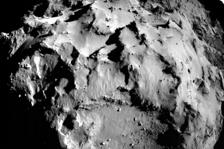 Comet 67P/CG, acquired by the ROLIS instrument on the Philae lander during descent from a distance of approximately 3 km (1.86 miles) from the surface is pictured in this November 12, 2014 European Space Agency (ESA) handout image. The ESA landed the