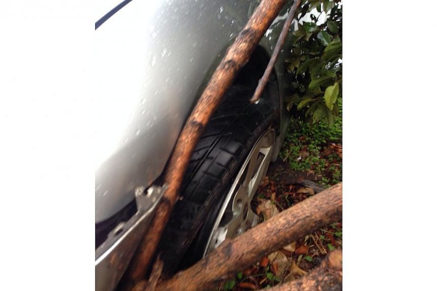 Madam Deng Ming Li was on the way to pick her three-year-old son up from his pre-school at Punggol End when she encountered a dangerous debris falling from a trailer. -- PHOTO: MING LI