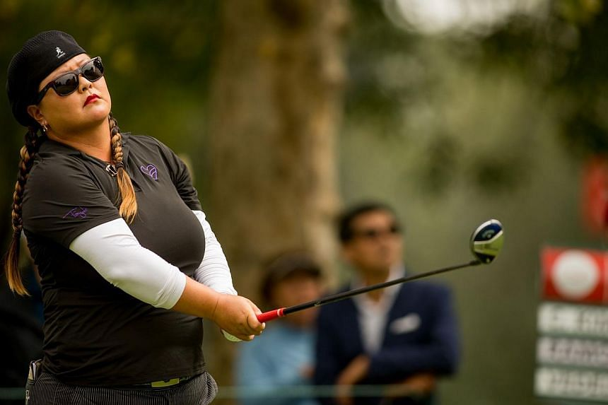 Christina Kim of the United States plays a tee shot at the fourth hole during the first round of the 2014 Lorena Ochoa Invitational presented by Banamex at Club de Golf Mexico on Nov 13, 2014, in Mexico City, Mexico.American Christina Kim, seek