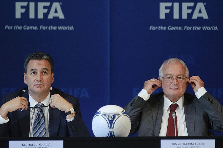 A file picture taken on July 27, 2012, shows Michael J Garcia (left), Chairman of the investigatory chamber of the FIFA Ethics Committee, and Hans-Joachim Eckert (right), Chairman of the adjudicatory chamber of the Fifa Ethics Committee taking part i