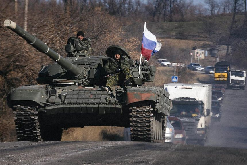 Pro-Russian separatists riding on a tank near the town of Krasnyi Luch in Lugansk region, eastern Ukraine. An angry, nuclear-armed Russia poses risks that we are only beginning to understand.