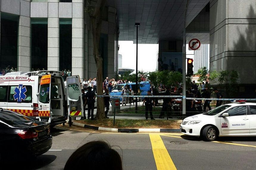 A fight between two men apparently broke out at Raffles Green during lunchtime on Friday, leaving one badly wounded.-- PHOTO: ROY CHNG