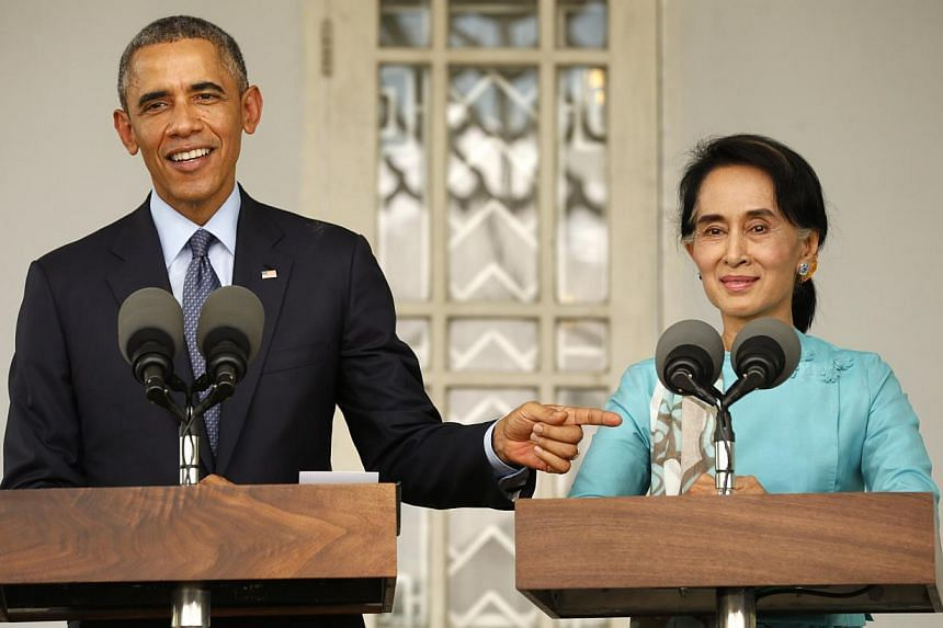 """US President Barack Obama and opposition politician Aung San Suu Kyi hold a press conference after their meeting at her residence in Yangon, on Nov 14, 2014.Opposition leader Aung San Suu Kyi on Friday described Myanmar's constitution as """"unfai"""
