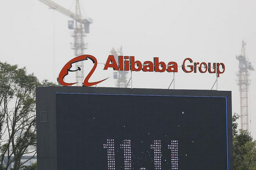 The logo of the Alibaba Group is seen inside the company's headquarters in Hangzhou, Zhejiang province on Nov 11, 2014. -- PHOTO: REUTERS