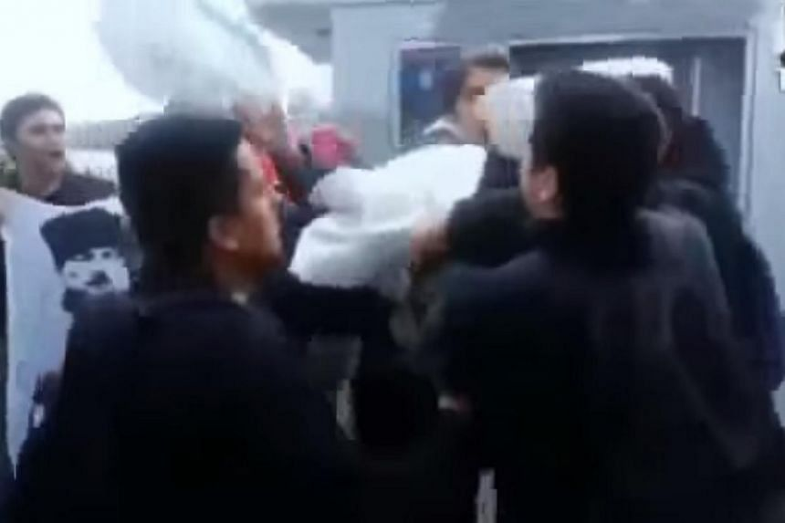 A screenshot from YouTube showing the attack on three US sailors by members of the nationalist Turkish Youth Union on a crowded street in Istanbul on Wednesday. Turkey's Foreign Minister on Friday described an assault on US sailors in Istanbul this w