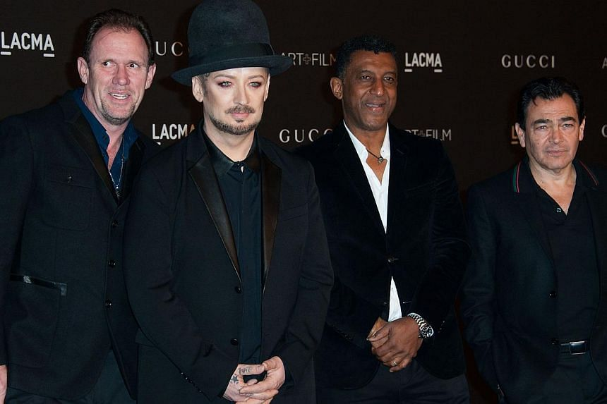 Recording artist Boy George (second left) and members of the band Culture Club arrive at an event honoring film director Quentin Tarantino and artist Barbara Kruger in Los Angeles on Nov 1, 2014. Boy George on Thursday called off a reunion tour of 19