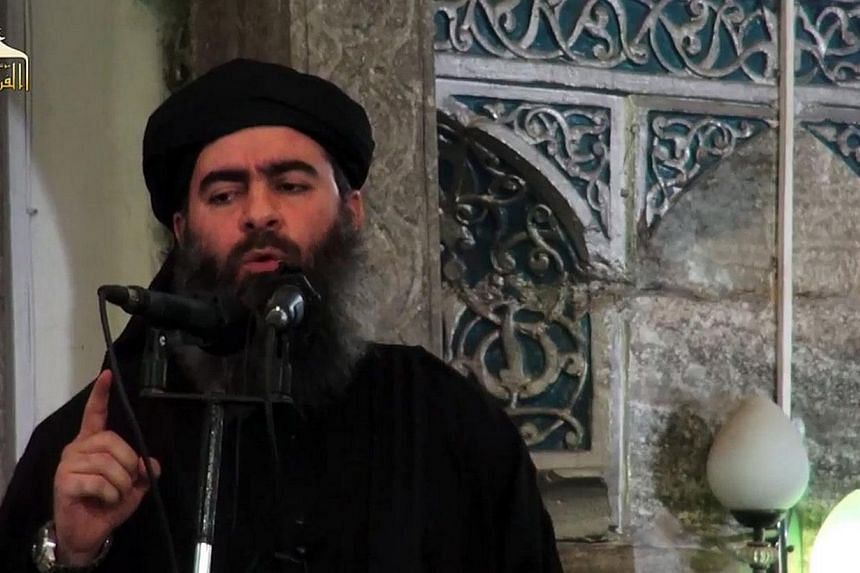 A file image grab taken from a propaganda video released on July 5, 2014 allegedly shows the leader of the Islamic State militant group, Abu Bakr al-Baghdadi adressing Muslim worshippers at a mosque in the militant-held northern Iraqi city of Mosul.