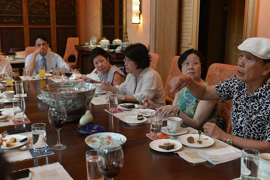 Mr Charlie Ong, Ms Lucy Lee (4th from right) and Ms Dinah Tan (2nd from right) had been working for Tangs for decades and recently retired. To thank them for their service, Mr Tang Wee Sung (left) invited them to his home for tea. -- ST PHOTO: CAROLI