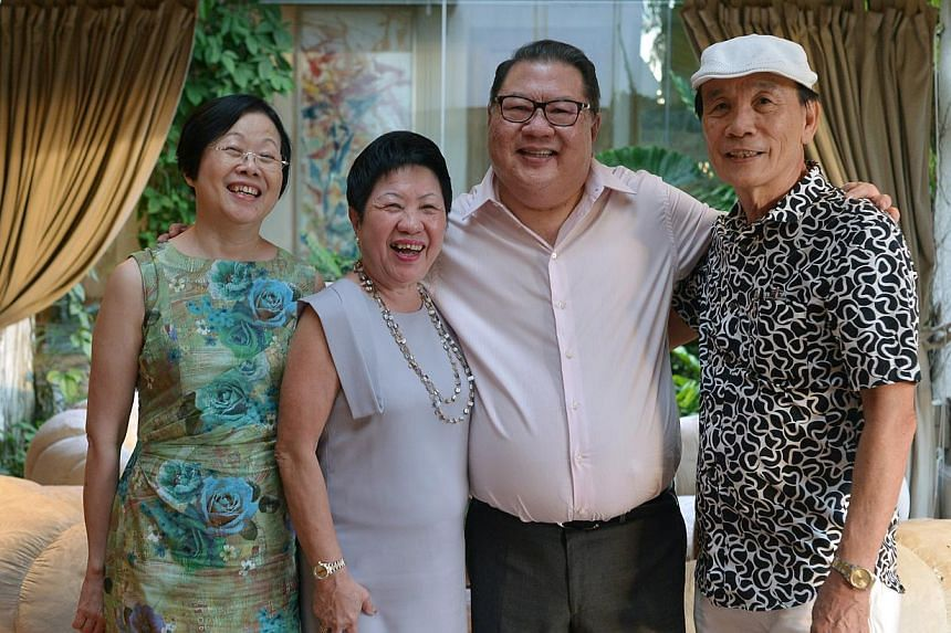 Mr Tang Wee Sung (2nd from right), chairman of Tangs, with Ms Dinah Tan (left), Ms Lucy Lee and Mr Charlie Ong. -- ST PHOTO: CAROLINE CHIA