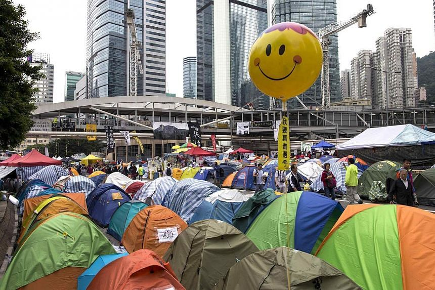 A balloon is seen over tents in an occupied area outside the government headquarters in Hong Kong Nov 13, 2014.Hong Kong democracy protest leaders said they will head to Beijing on Saturday in hopes of bringing their demands for political