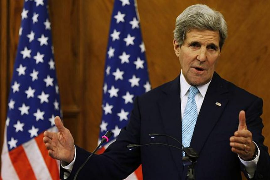 US Secretary of State John Kerry speaks during a joint news conference with Jordan's Foreign Minister Nasser Judeh at the Ministry of Foreign Affairs in Amman Nov 13, 2014.Kerry said Thursday that steps were agreed at talks in Amman to lower tensions