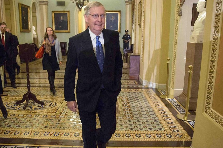 Senate Minority Leader Mitch McConnell arrives at his office before a closed conference meeting to conduct leadership elections for the next Congress on Capitol Hill in Washington Nov 13, 2014. Senate Republicans on Thursday unanimously elected Mitch