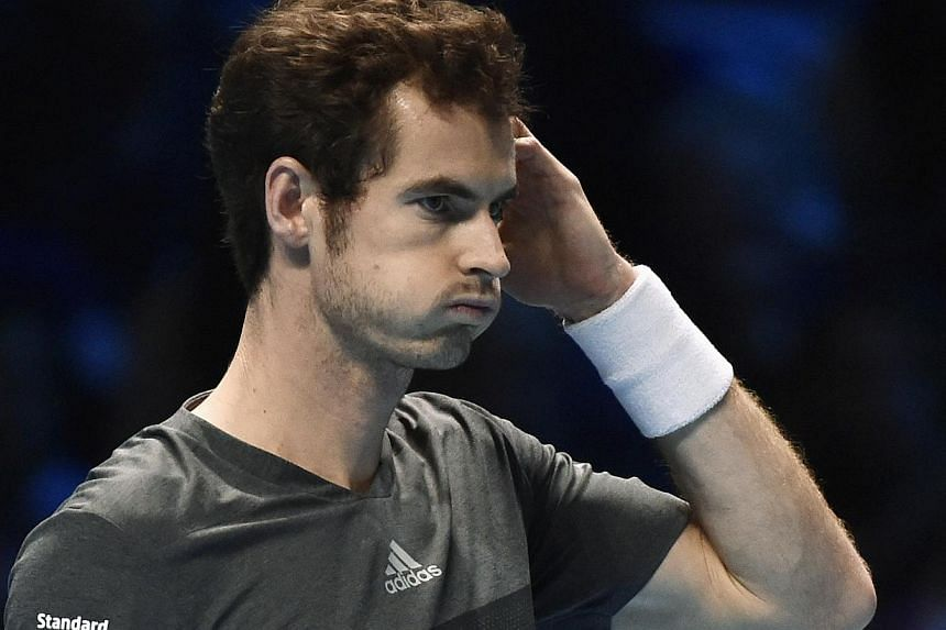 Andy Murray of Britain reacts during his tennis match against Roger Federer of Switzerland at the ATP World Tour finals at the O2 Arena in London Nov 13, 2014. Roger Federer allowed Andy Murray only eight points in a 6-0 first set in their ATP World