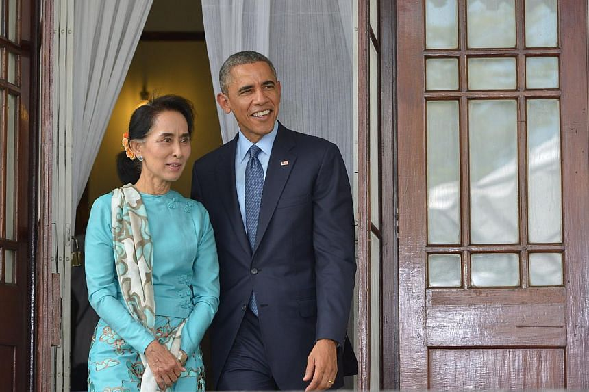 US President Barack Obama and Myanmar's opposition leader Aung San Suu Kyi speak during a press conference at her residence in Yangon on Nov 14, 2014. -- PHOTO: AFP