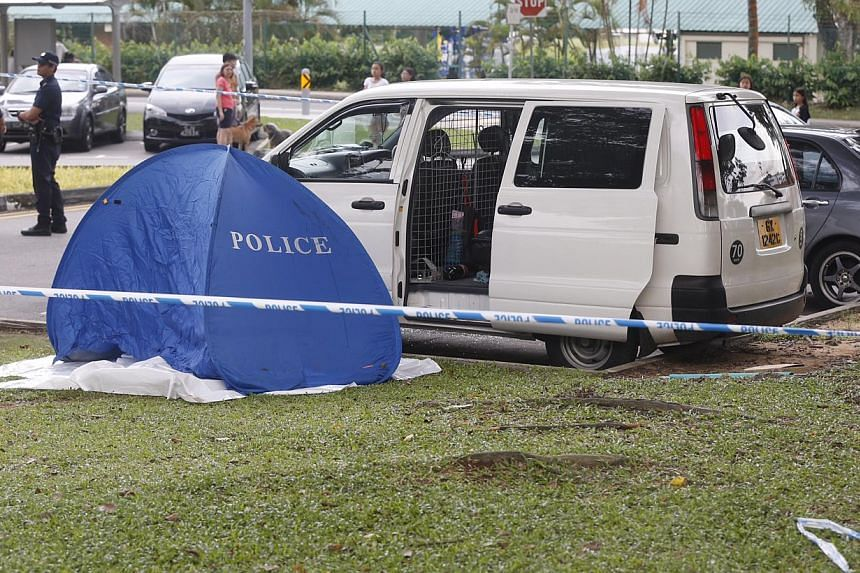 A body was found next to a white van with shattered glass on the door of the driver's side at Sembawang Park on Nov 14, 2014. -- ST PHOTO: KEVIN LIM