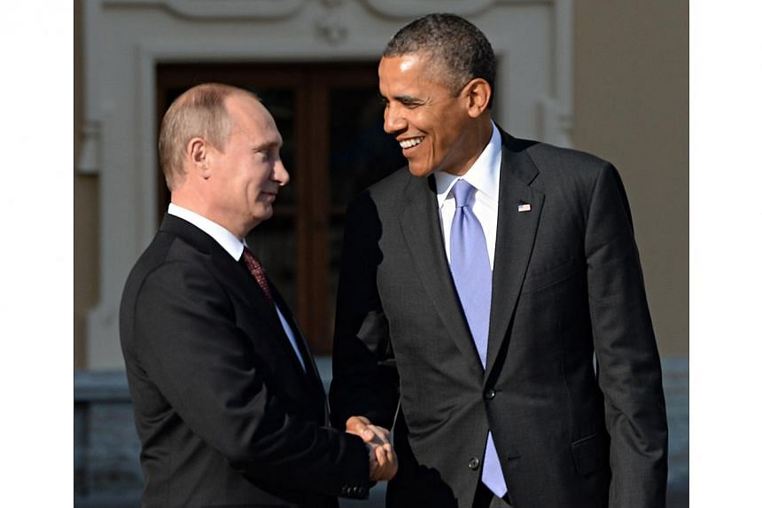 US President Barack Obama is greeted by Russian President Vladimir Putin as he arrives at the official welcome ceremony of the G20 Leaders' Summit in St. Petersburg, Russia on Sept 5, 2013.President Vladimir Putin accused the United States on F