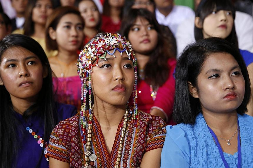 Students listen to US President Barack Obama speak at Yangon University in Yangon Nov 14, 2014. Myanmar activists greeted US President Barack Obama with placards decrying the slow pace of reform in their country as he attended a lively public meeting