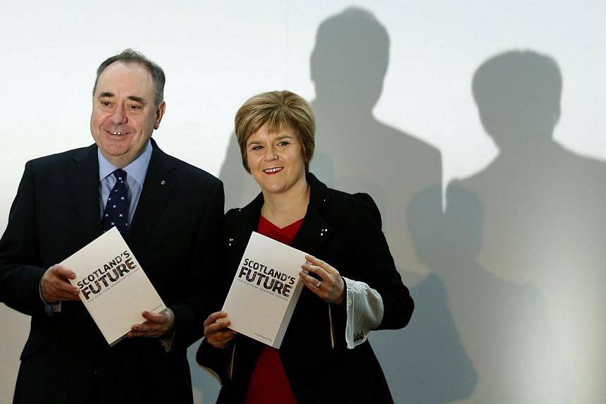 A file photograph show Scotland's First Minister Alex Salmond (left) and deputy First Minister Nicola Sturgeon holding copies of the referendum white paper on independence during its launch in Glasgow, Scotland Nov 26, 2013.Salmond will s